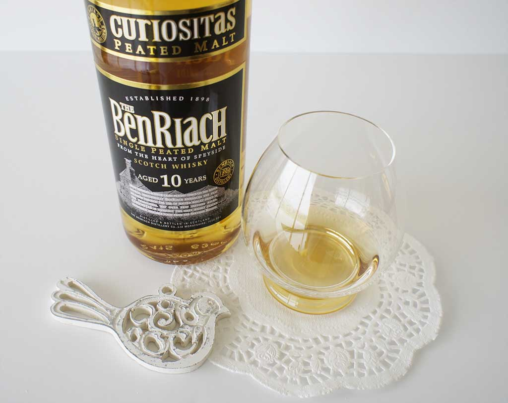 BenRiach Curiositas 10 yo whisky with glass