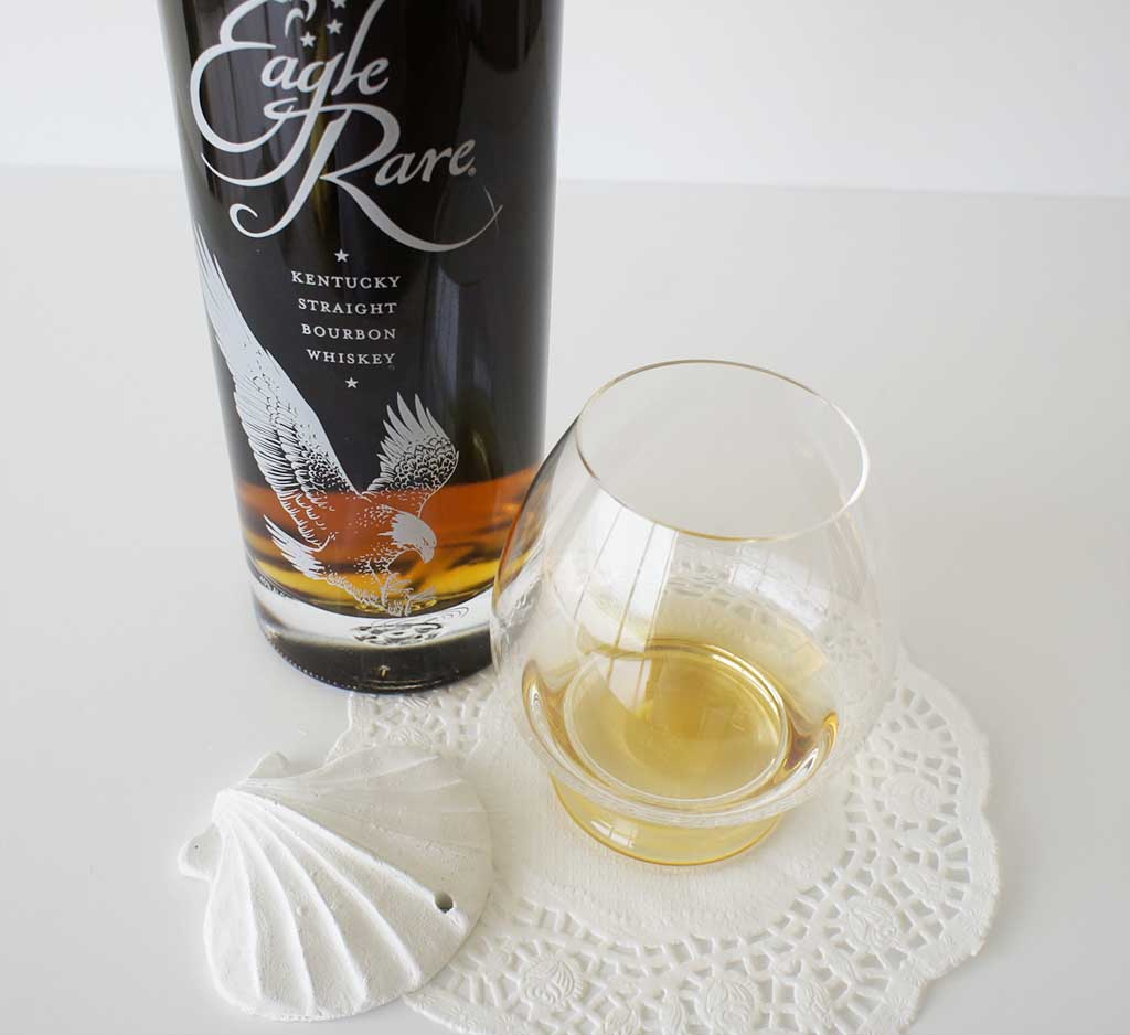Eagle Rare Kentucky Bourbon whiskey with glass National Bourbon Day