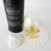 Ardbeg Dark Cove whisky with glass