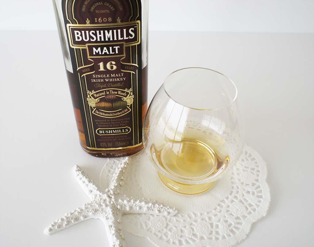 Bushmills 16 yo whiskey with glass