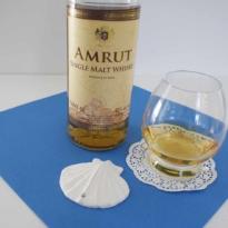 Amrut single malt whisky with glass