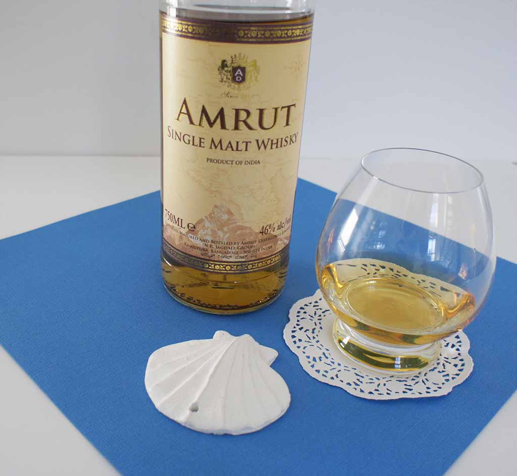 Amrut single malt whisky with glass