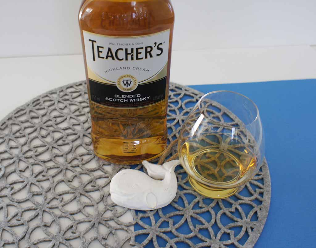 Teachers Blended whisky with glass Teacher's Highland Cream