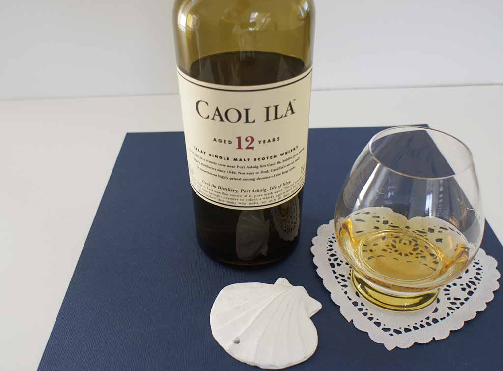 Caol Ila 12 yo whisky with glass