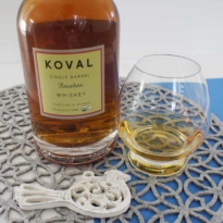 Koval single barrel bourbon whiskey with glass
