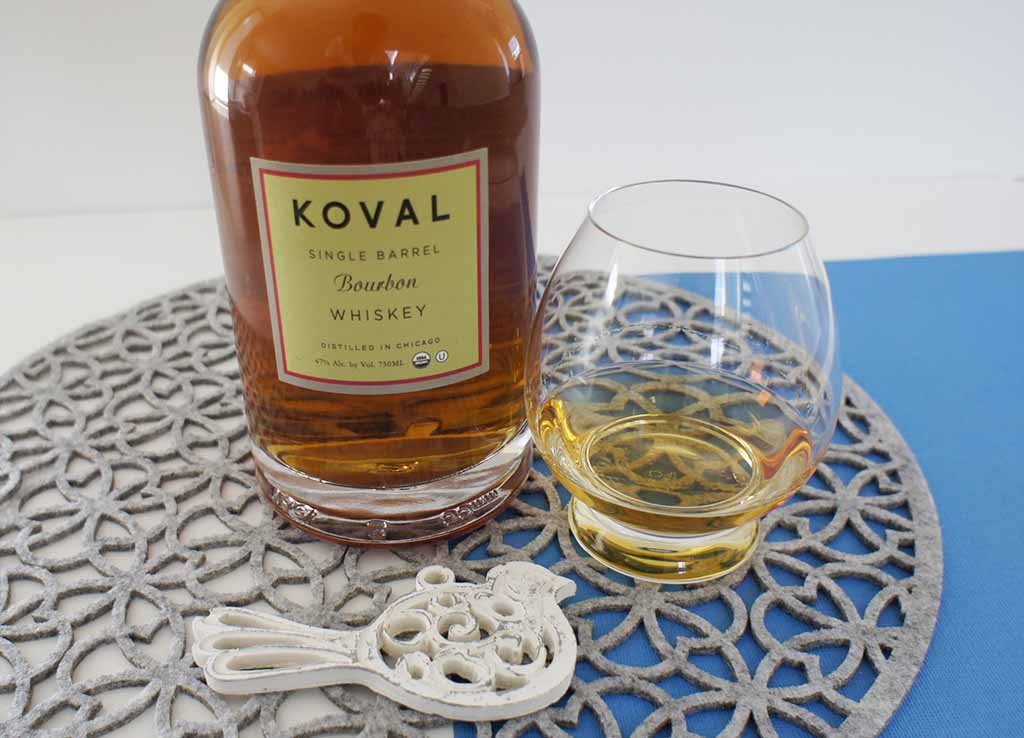 Koval single barrel bourbon whiskey with glass Koval bourbon