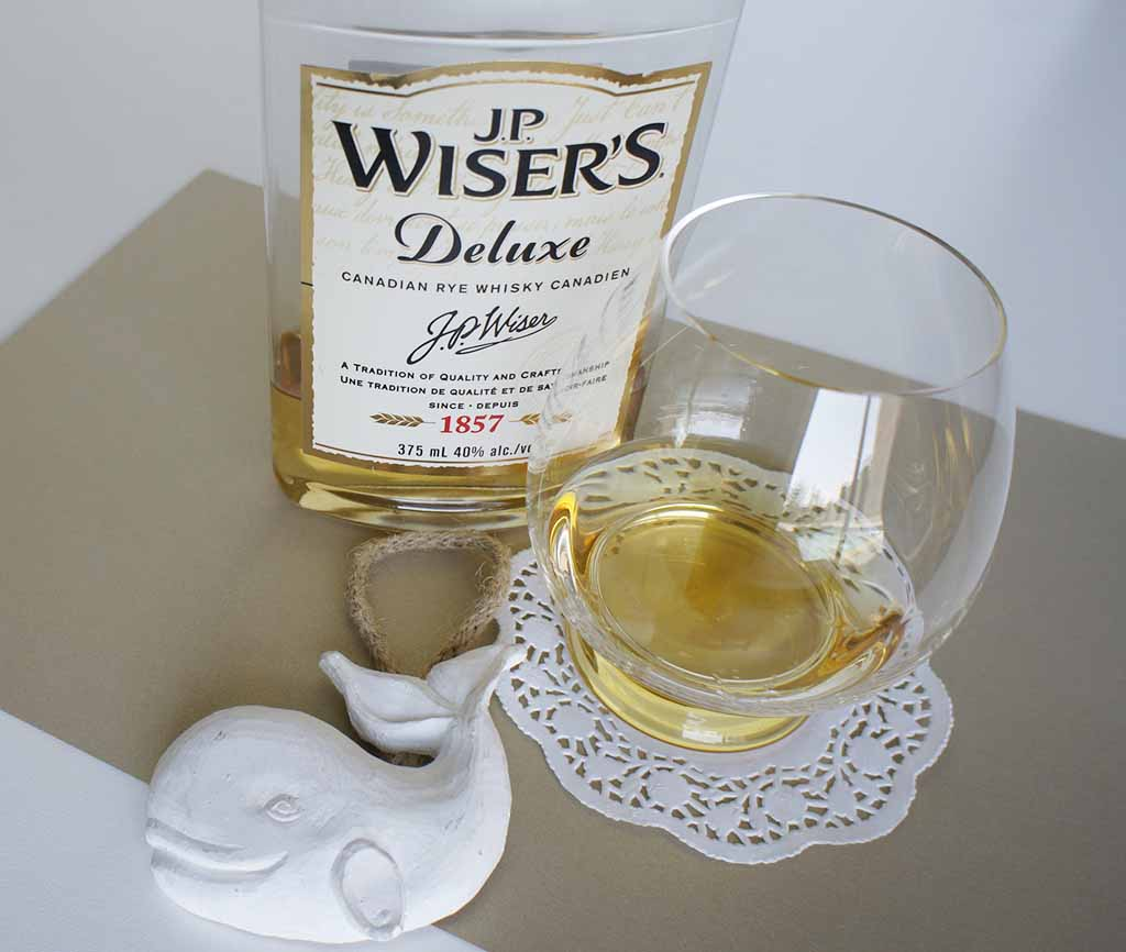 JP Wiser's Deluxe Canadian Rye whisky with glass JP Wiser's Deluxe