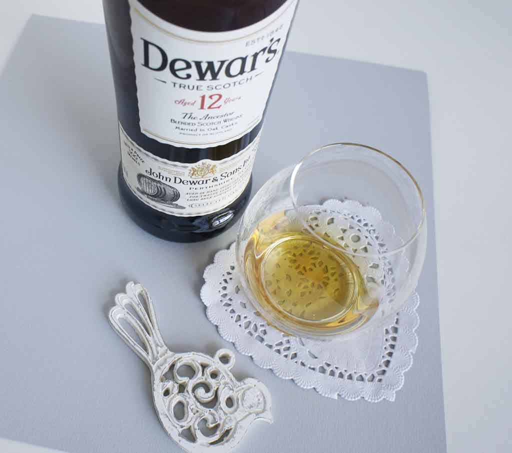 Dewar's 12 yo blended whisky with glass Dewar's 12 yo Dewars 12 yo dewars-12-yo