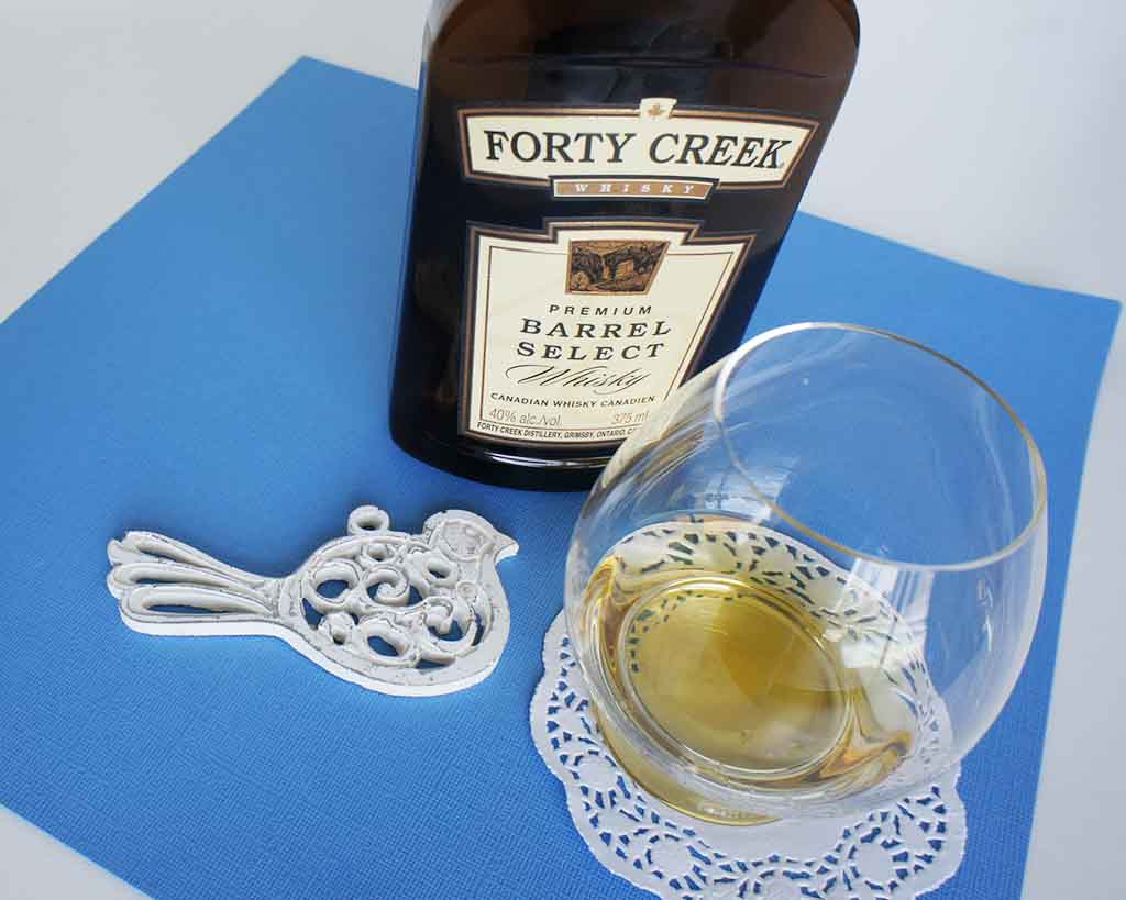 Forty Creek Barrel Select Canadian whisky with glass