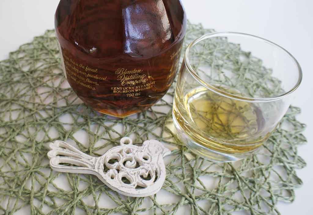 Blanton's gold bourbon with glass